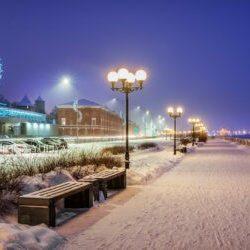 Volga Embankment in Nizhny Novgorod, benches and lights on a winter snowy evening
