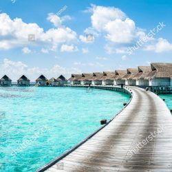 stock-photo-beach-holiday-in-a-luxury-resort-with-overwater-bungalow-indian-ocean-maldives-1336843943